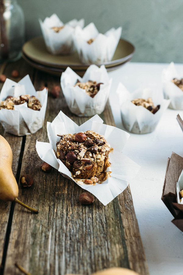 Vegan hazelnut pear and chocolate muffins are sweetened with pears, lavished with dark chocolate buttons & topped with toasted hazelnut chocolate streusel.