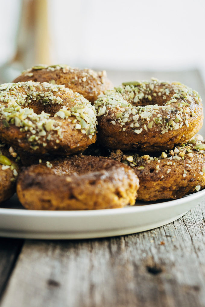 Sneaky Spiced Pumpkin Baked Doughnuts are so-good-you-can't-stop-eating-them vegan doughnuts that hide no less than three vegetables. They'll never know.