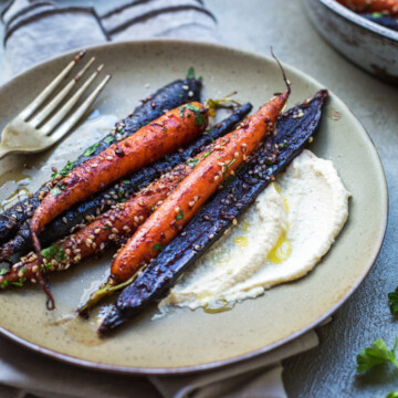 A plate of miso roasted carrots with sauce