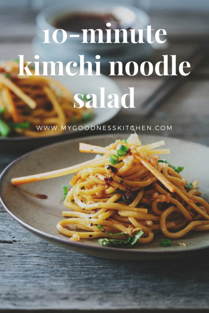 Two plates of 10-minute kimchi noodle salad, one close up, on a rustic wooden table with chopsticks in the background with title text overlay