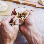 A man making a bao bun