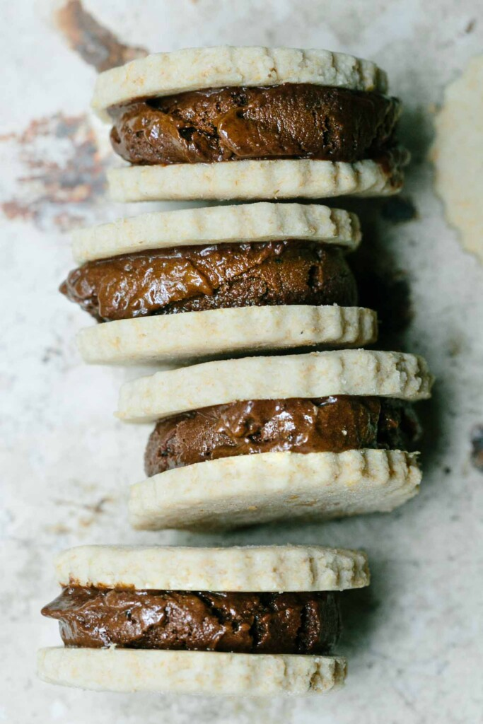 Made with avocado and banana, these pretty darn healthy chocolate ice-cream sandwiches combine buttery shortbread with a creamy chocolate centre.