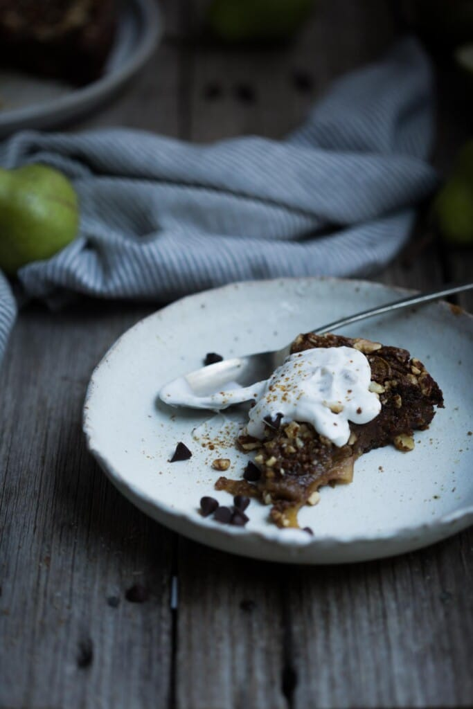 This vegan Flourless Dark Chocolate and Pear Cake boasts sweetly cooked pear slivers nestled within a dark chocolate infused almond cake crumb.