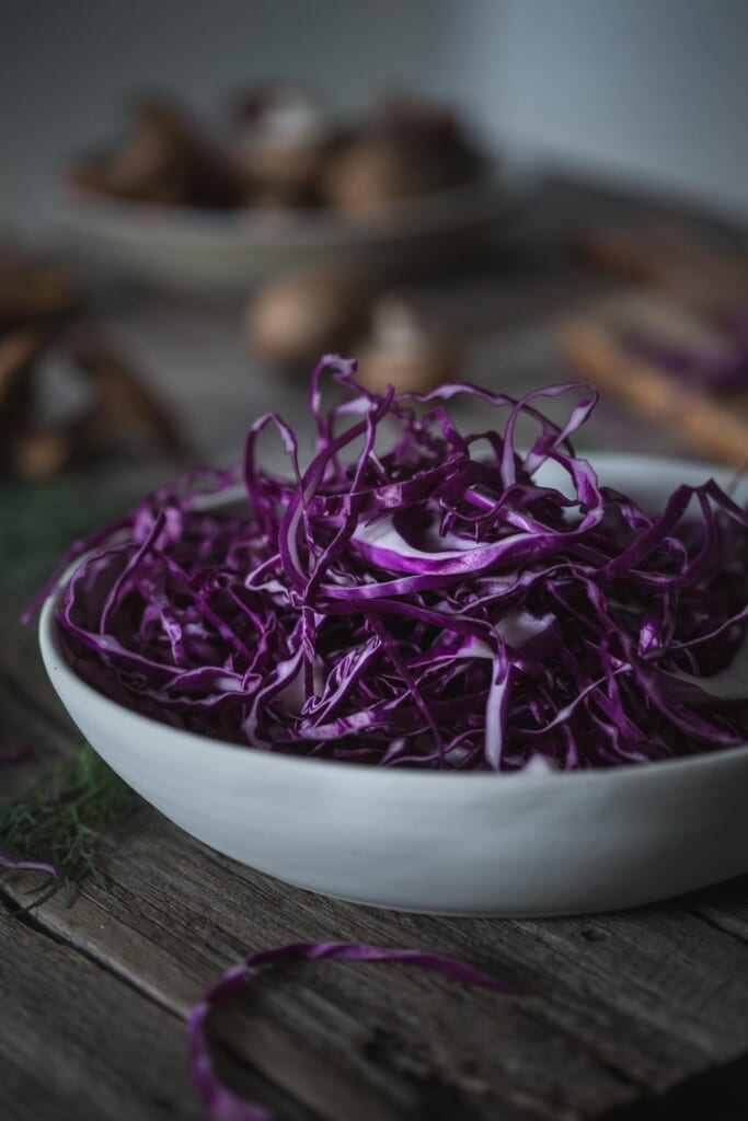 A large bowl of shredded red cabbage