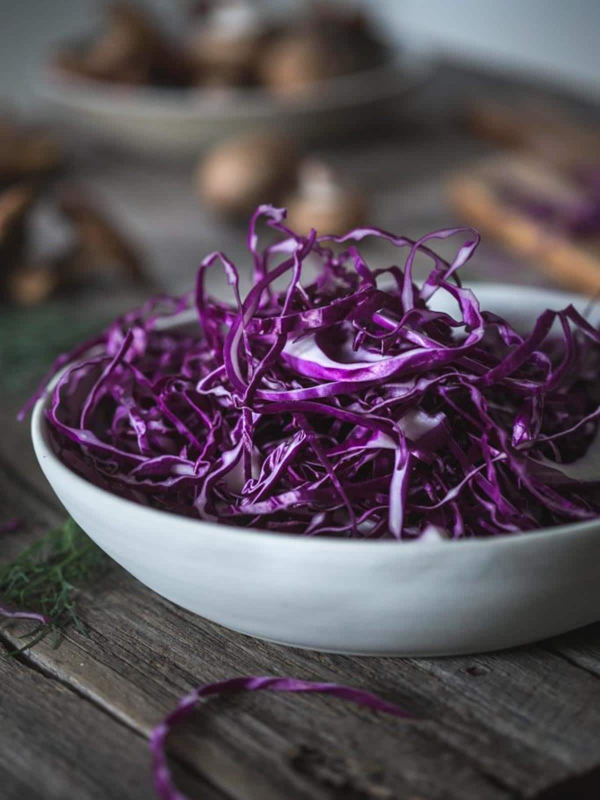 A bowl of thinly sliced red cabbage.