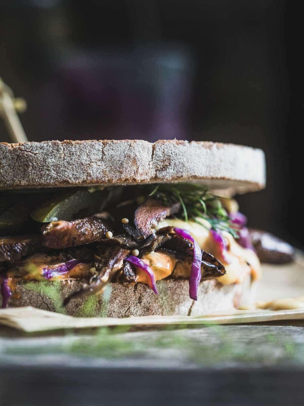 A toasted reuben sandwich close up.