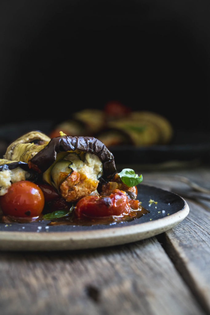 This vegan eggplant involtini combines homemade cashew ricotta with sweet onion rolled in zucchini ribbons and baked eggplant.
