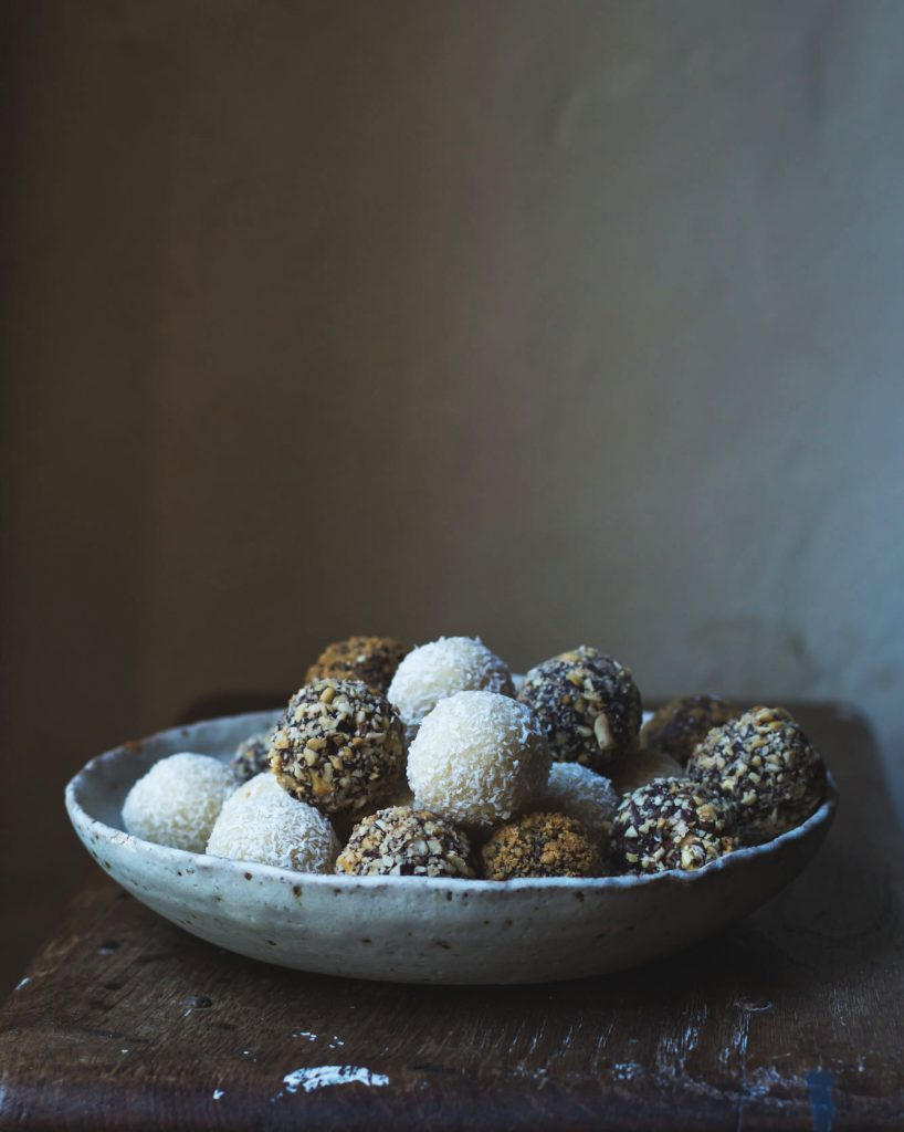 rustic bowl of truffles on a wooden stool