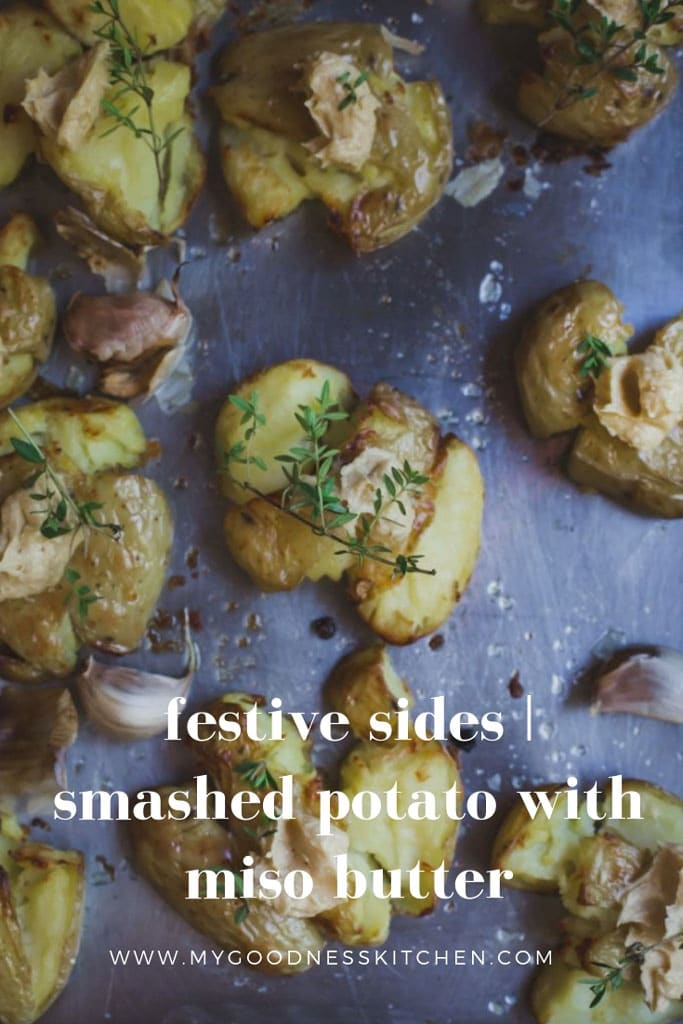 An overhead image of roasted smashed potatoes with herbs with text.