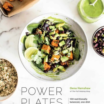 The cover of a cookbook with bowls of salad.