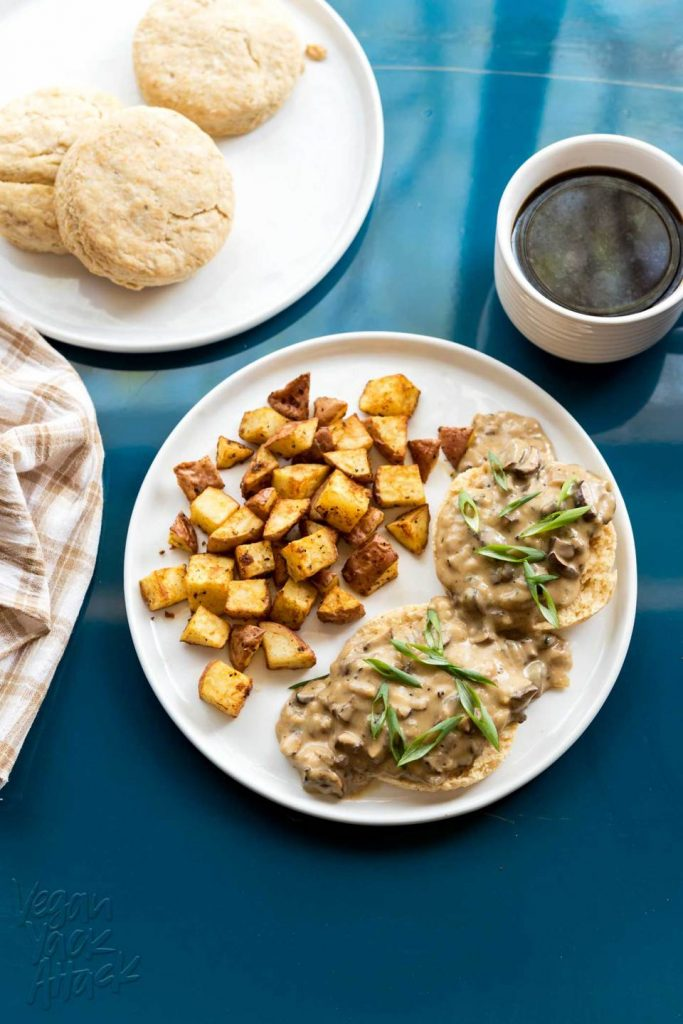 An overhead image of vegan biscuits and gravy with a cup of coffee