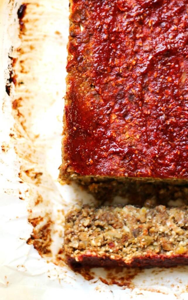 A close up overhead shot of vegan lentil cauliflower loaf on white paper