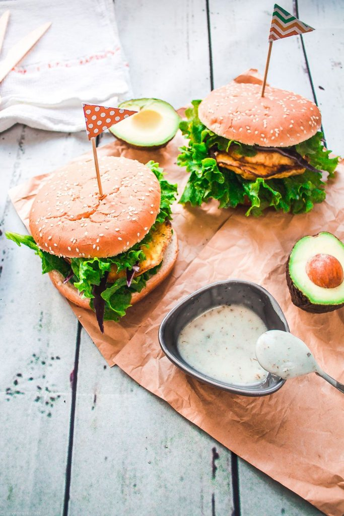 Two oven-baked celeraic cutlet burgers sitting on brown textured paper