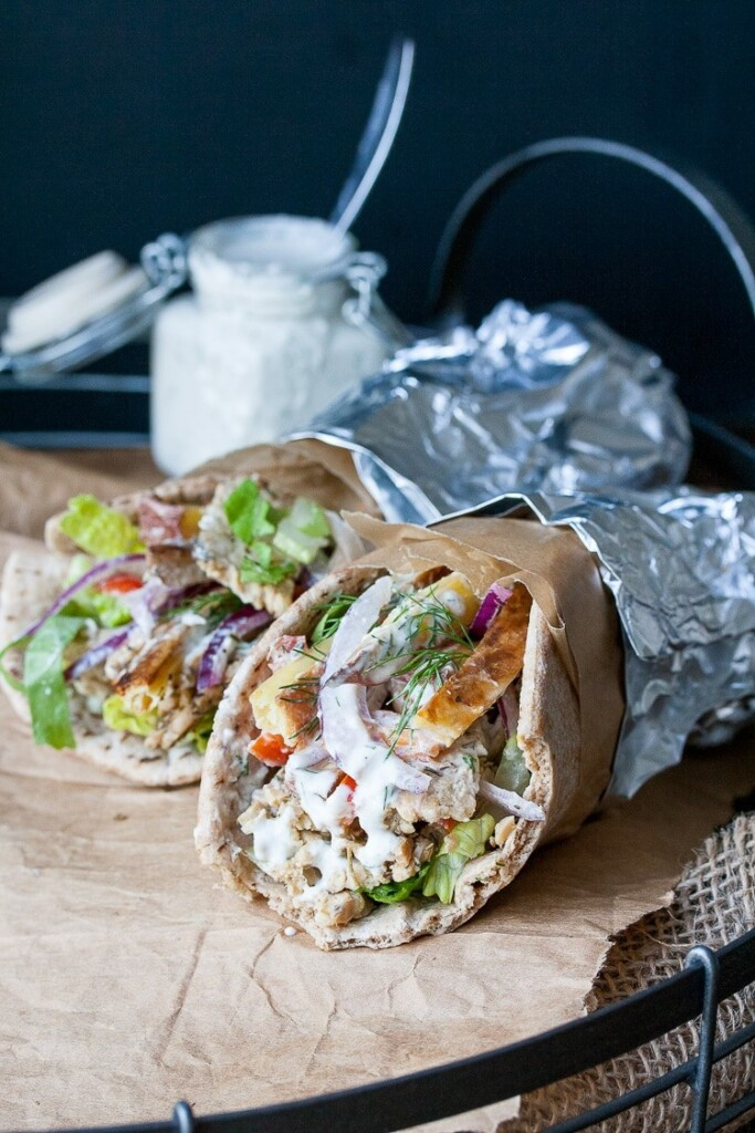 Two vegan Greek Gyros with tempeh on brown parchment
