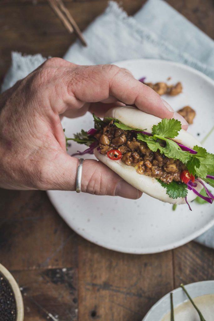Vegan Bao Burgers with Peking Tempeh - My Goodness Kitchen - hand