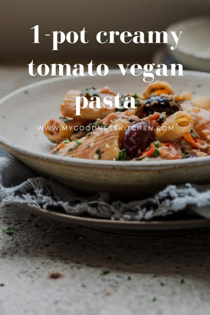 a close up image of 1-pot creamy tomato vegan pasta with text