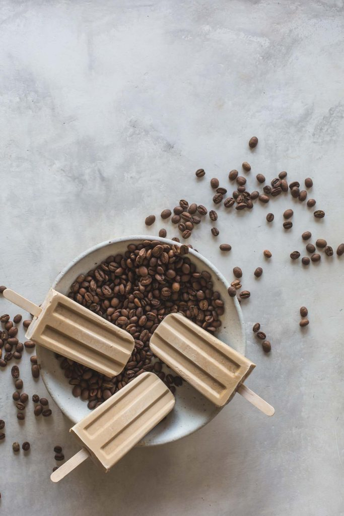 Made with coconut milk, coconut condensed milk and a touch of cardamom these spiced Thai iced coffee popsicles are simple, exotic and yum | beans, popsicles and bowl