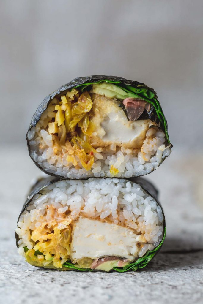 Crisp tofu, sweet sushi rice, creamy avocado with spiced chipotle, pickled ginger and kimchi this crispy tofu sushi burrito is a fusion party