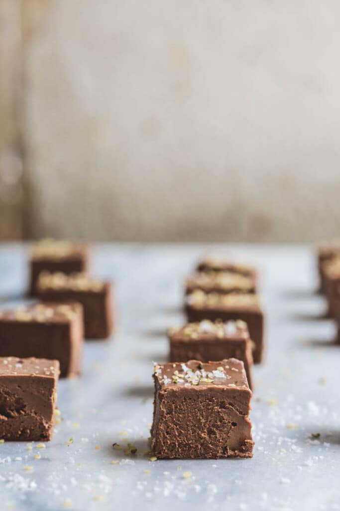 A front on image of rows of sweet potato chocolate squares on a marble surface