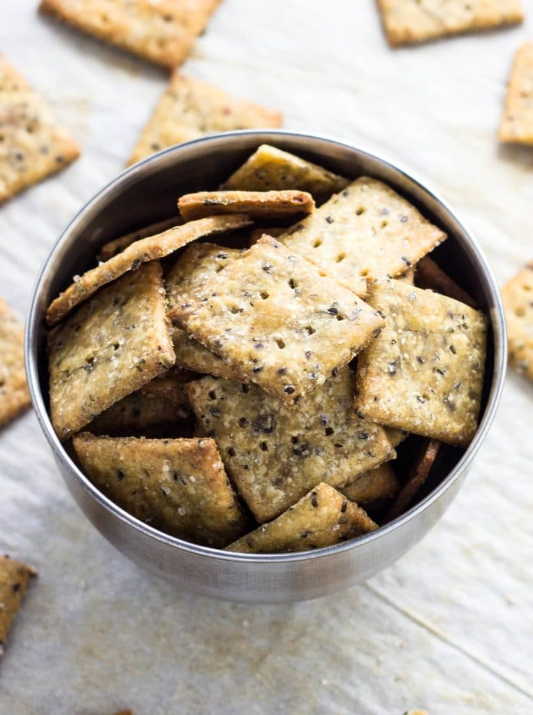 Square homemade crackers in a bowl.