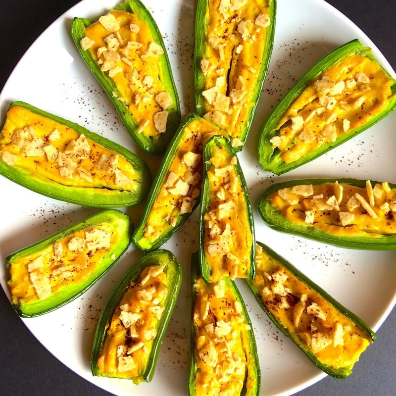 Stuffed peppers on a white plate.
