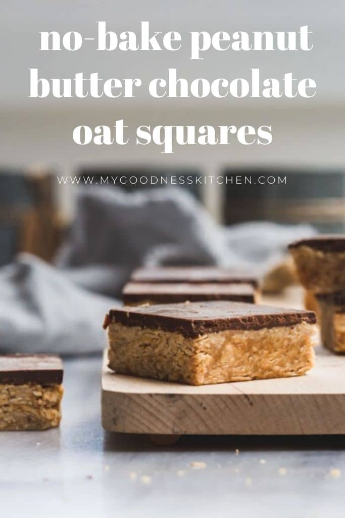 Peanut butter oatmeal squares with chocolate on a wooden board with text
