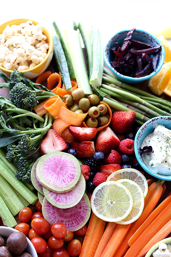 A platter of fresh fruit and vegetables.