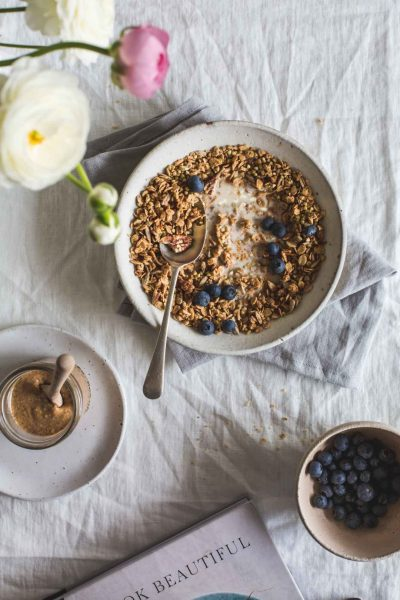 Inspired by Purely Elizabeth's granola, this homemade almond butter maple granola is deliciously moreish being a little salty and a little sweet.