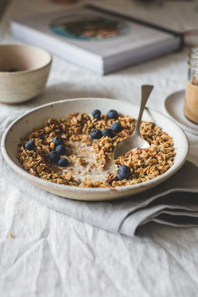 Bowl of Maple Almond Butter Granola in a bowl on a breakfast table