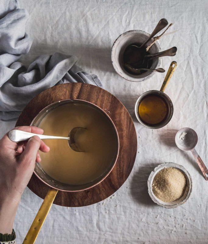 Vegan brandy sauce being stirred in a pot
