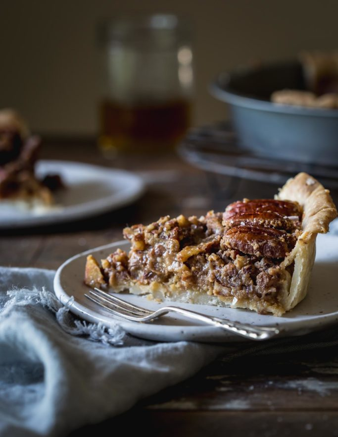 Close-up image of gooey vegan pecan pie slice