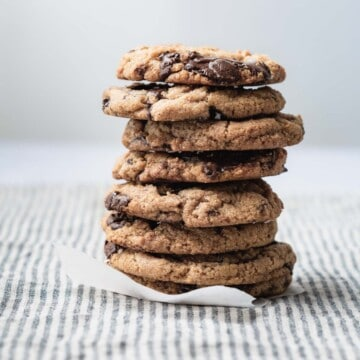 A tall stack of chocolate chip cookies.