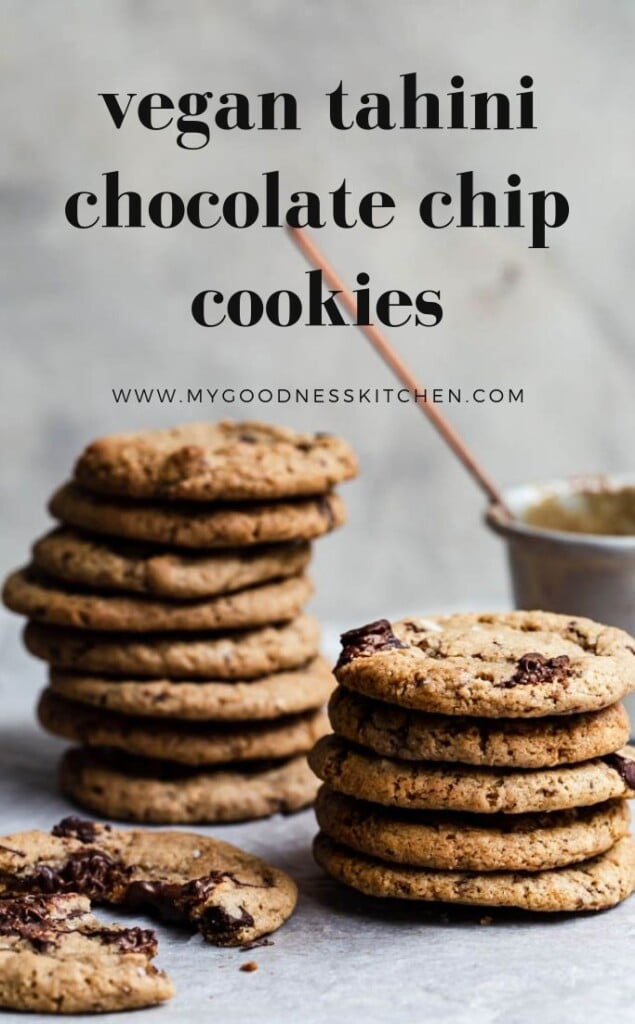 stacks of tahini chocolate chip cookies on a rustic surface with a pot of tahini with a spoon nearby with title text overlay