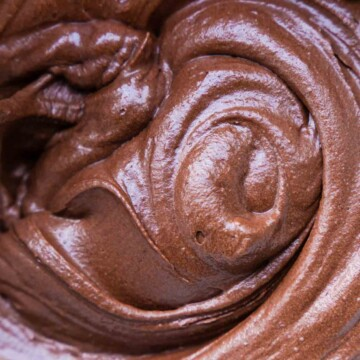 A close up of a swirl of chocolate frosting