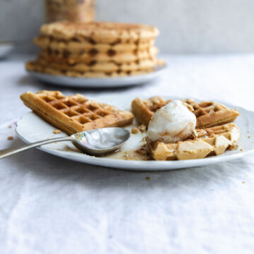 A plate of waffles with a spoon