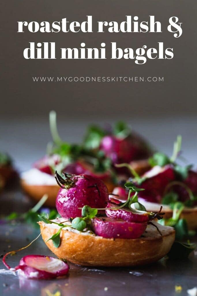 A front on image of a tray of roasted radishes sitting on mini bagels with cream cheese and micros greens. Front bagel in focus. Title text in white.