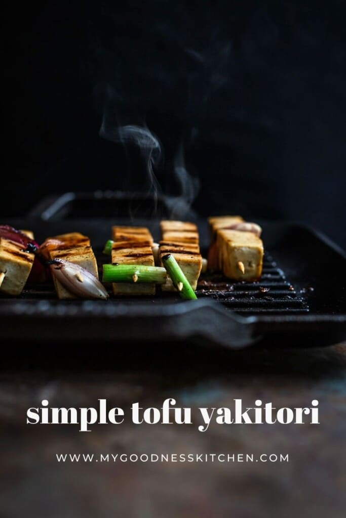 front on image of tofu yakitori grilling on a Lodge grill pan with smoke coming off the pan with title text in white