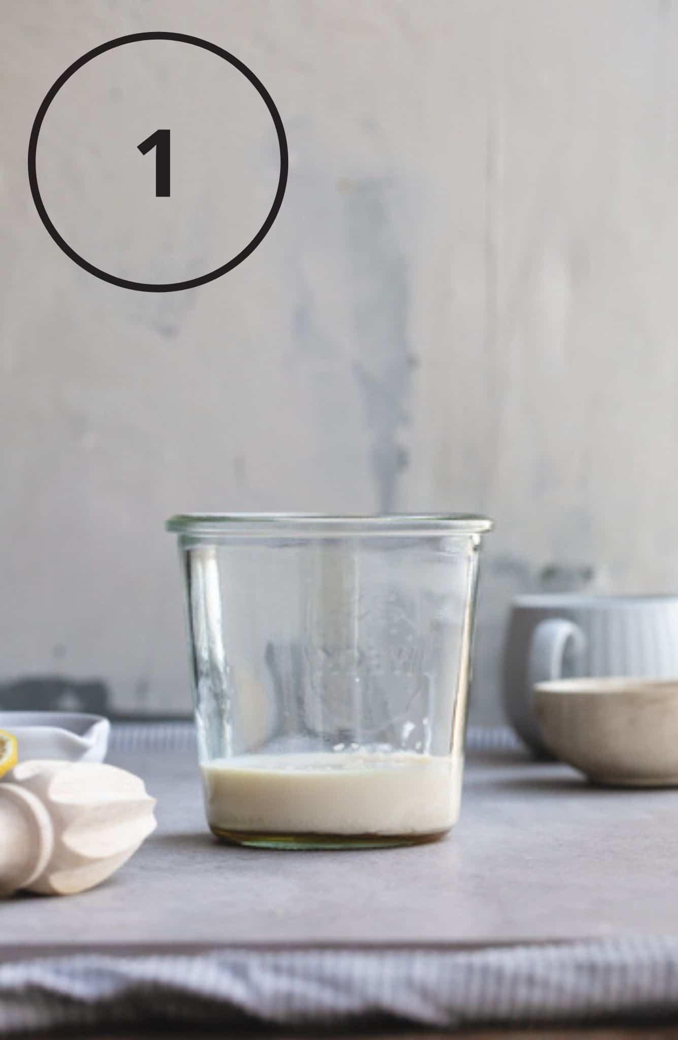 A jar of ingredients before blending.