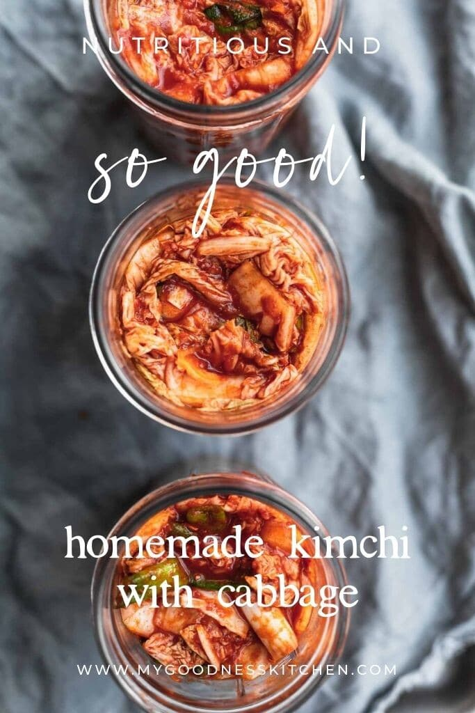 Overhead image of jars filled with kimchi on a blue background