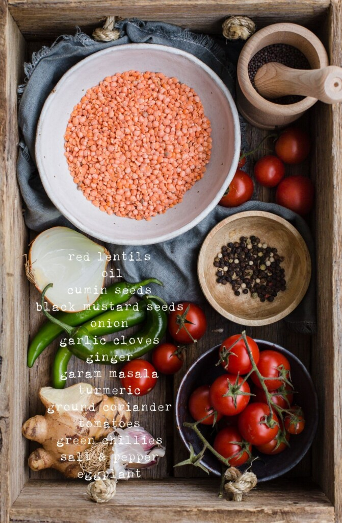 An overhead image of a wooden box filled with the Masoor Dal ingredients before cooking