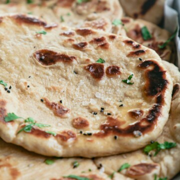 A close up of a stack of naan breads