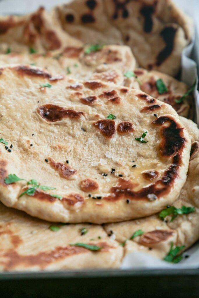 Close up image of freshly made homemade vegan naan bread.
