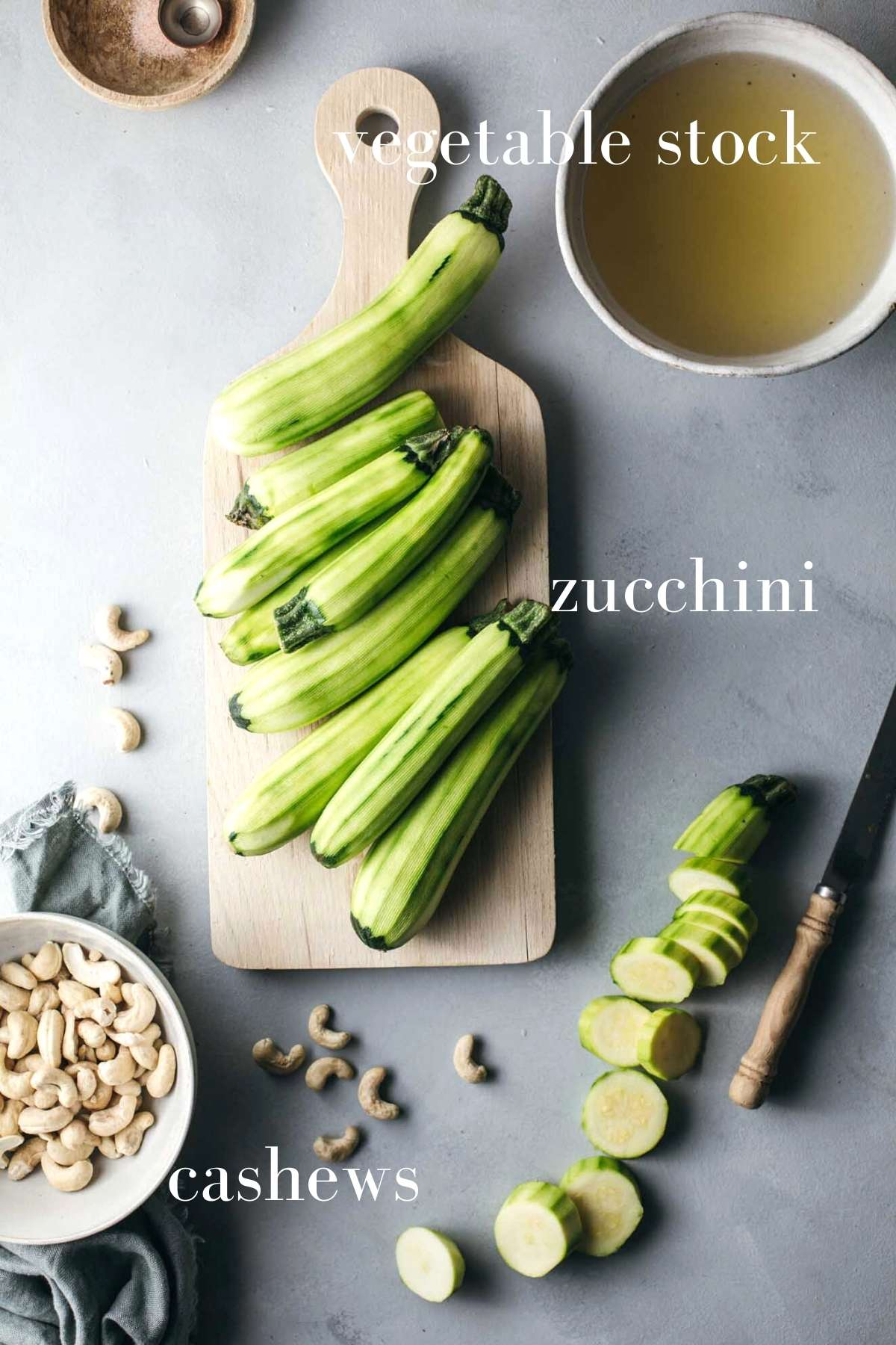 Zucchini soup ingredients on a chopping board.
