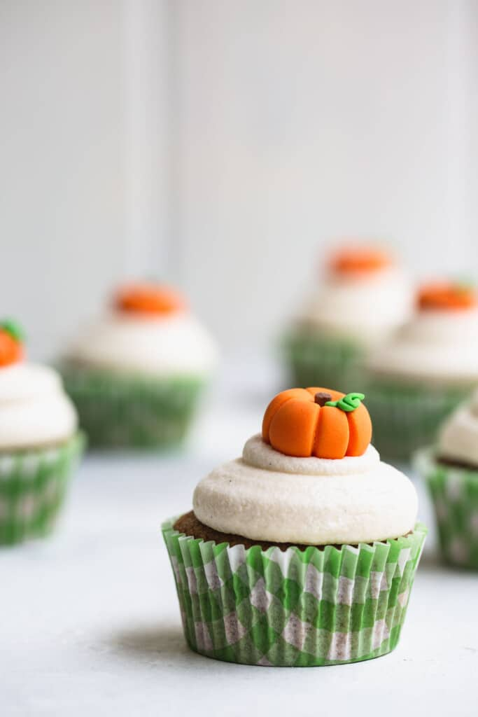 Pumpkin cupcakes on a white table