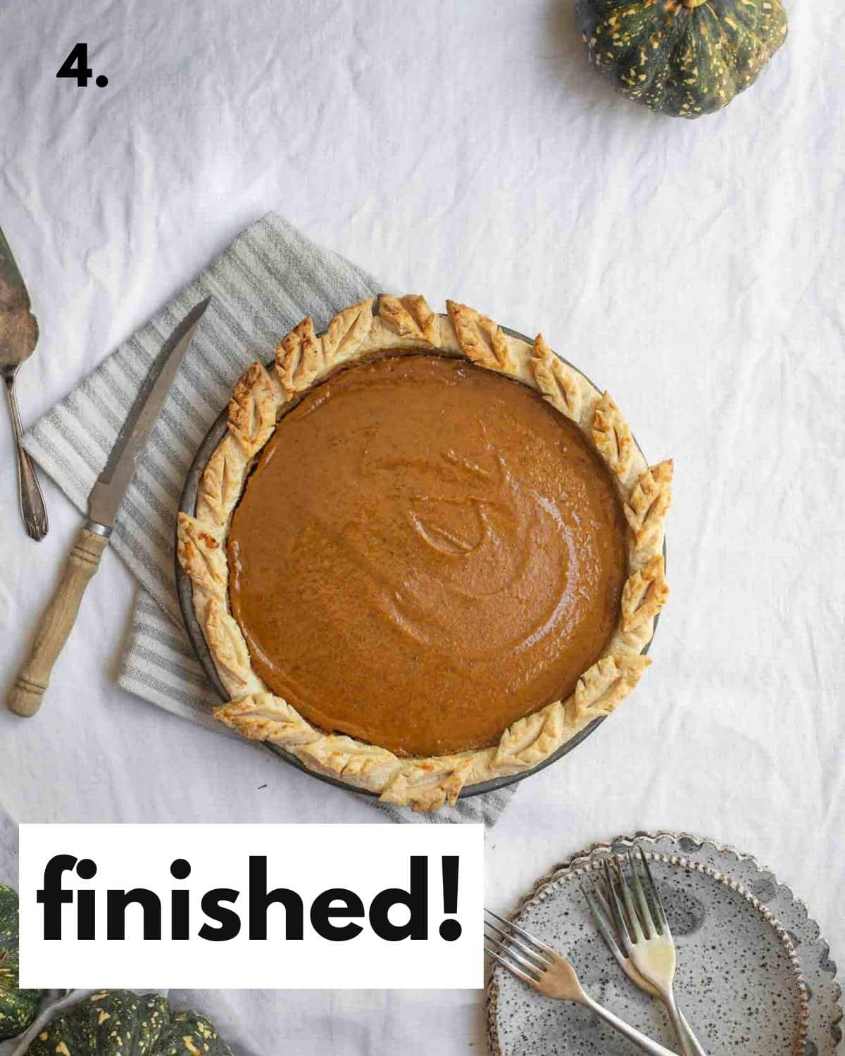 Finished pumpkin pie sitting on a table.