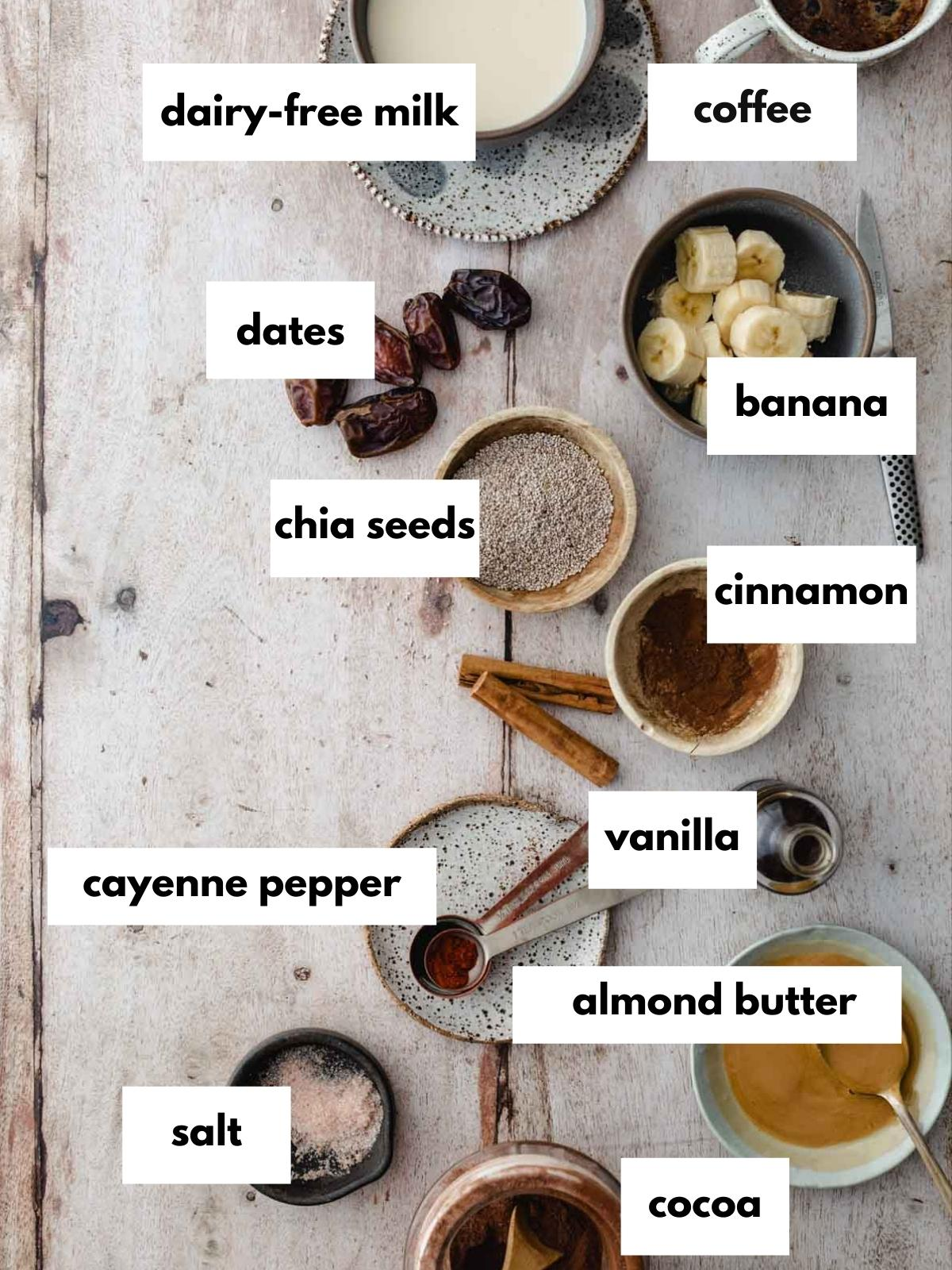Chocolate chia pudding ingredients laid out on a table.