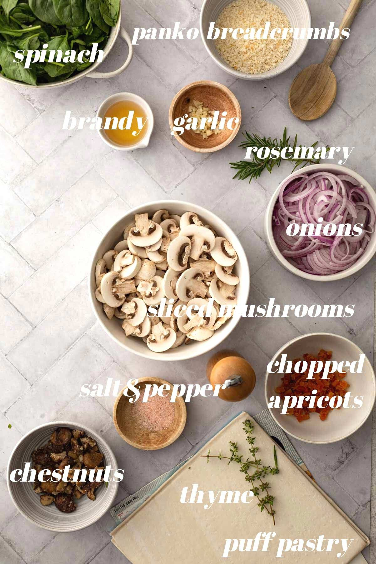 Vegan Wellington ingredients in bowls sitting on a marble background.