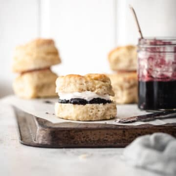 Freshly baked scones with jam and cream.