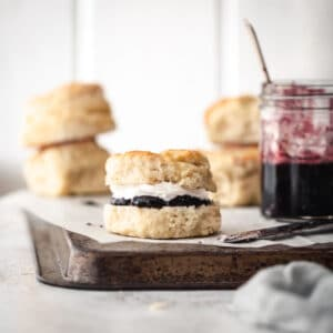 Baked scones on a board with jam.