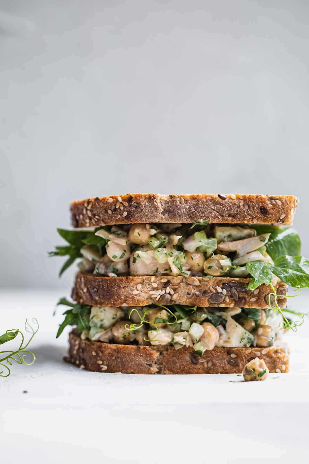 A double sandwich sitting on a white board.